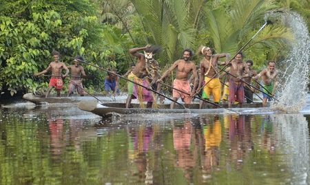 new guinea: INDONESIA, IRIAN JAYA, ASMAT PROVINCE, JOW VILLAGE - JUNE 23: Canoe war ceremony of Asmat people. Headhunters of a tribe of Asmat . New Guinea Island, Indonesia. June 23, 2016