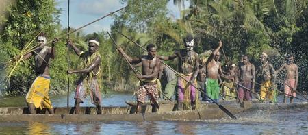 cannibal: INDONESIA, IRIAN JAYA, ASMAT PROVINCE, JOW VILLAGE - JUNE 23: Canoe war ceremony of Asmat people. Headhunters of a tribe of Asmat . New Guinea Island, Indonesia. June 23, 2016