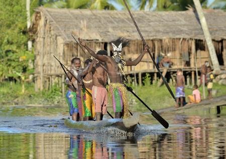 INDONESIA, IRIAN JAYA, ASMAT PROVINCE, JOW VILLAGE - JUNE 23: Canoe war ceremony of Asmat people. Headhunters of a tribe of Asmat . New Guinea Island, Indonesia. June 23, 2016
