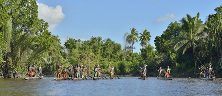 INDONESIA, IRIAN JAYA, ASMAT PROVINCE, JOW VILLAGE - JUNE 23: Canoe war ceremony of Asmat people. Headhunters of a tribe of Asmat. New Guinea Island, Indonesia. June 23, 2016 Editorial