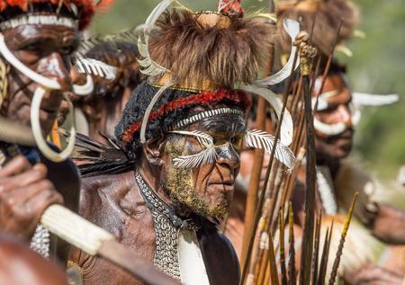 DANI VILLAGE, WAMENA, IRIAN JAYA, NEW GUINEA, INDONESIA, 4 JUNE 2016: Close up Portrait of Yali Mabel, the chief of Dani tribe. Dugum Dani Warrior. June 4, 2016. Baliem Valley,
