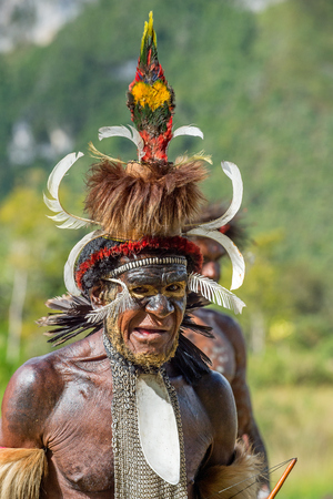DANI VILLAGE, WAMENA, IRIAN JAYA, NEW GUINEA, INDONESIA, 4 JUNE 2016: Close up Portrait of Yali Mabel, the chief of Dani tribe. Dugum Dani Warrior. June 4, 2016. Baliem Valley,