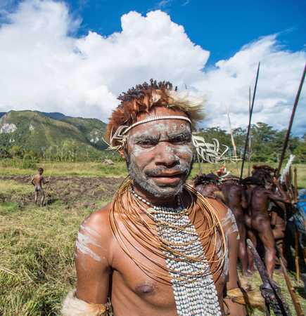 DANI VILLAGE, WAMENA, IRIAN JAYA, NEW GUINEA, INDONESIA, 4 JUNE 2016: Close up Portrait of Dugum Dani Warrior Portrait. June 4, 2016 The Baliem Valley Papua or Irian Jaya Indonesian New Guinea
