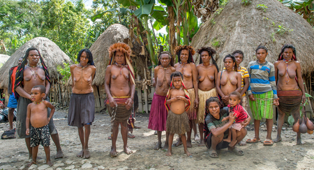 BALIEM VALLEY, WEST PAPUA, INDONESIA, JUNE 4, 2016: Dugum Dani tribe people on Welcoming Ceremony. Woman and children of Dani tribe people. New Guinea Island , Iran Jaya, Indonesia