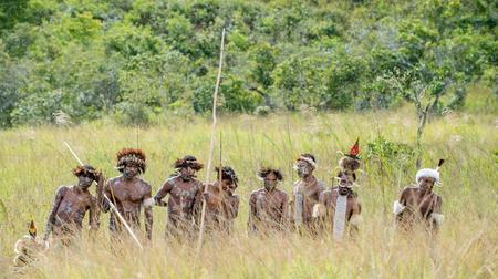 DANI VILLAGE, WAMENA, IRIAN JAYA, NEW GUINEA, INDONESIA - JUNE 4:The  armed group of Papuans. Group of Warriors of Dani Dugum tribe prepare for war. June 4, 2016, New Guinea Island.