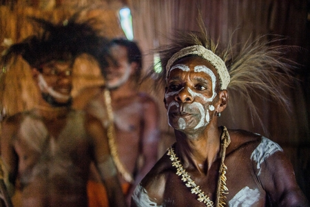 YOUW VILLAGE, ATSY DISTRICT, ASMAT REGION, IRIAN JAYA, NEW GUINEA, INDONESIA - MAY 23, 2016: Portrait of a man from the tribe of Asmat people in the ritual face painting.  New Guinea. May 23, 2016