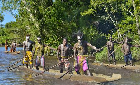 INDONESIA, IRIAN JAYA, ASMAT PROVINCE, JOW VILLAGE - MAY 23: Canoe war ceremony of Asmat people. Headhunters of a tribe of Asmat . New Guinea Island, Indonesia. May 23, 2016 Editorial