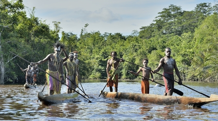 INDONESIA, IRIAN JAYA, ASMAT PROVINCE, JOW VILLAGE - MAY 23: Canoe war ceremony of Asmat people. Headhunters of a tribe of Asmat . New Guinea Island, Indonesia. May 23, 2016 Editorial