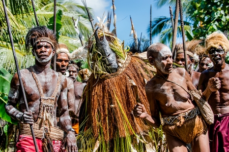 YOUW VILLAGE, ATSY DISTRICT, ASMAT, NEW GUINEA, INDONESIA - MAY 23: The Village follows the ancestors embodied in spirit mask as they tour the village. Jjungle of New Guinea.Indonesia. May 23, 2016 에디토리얼