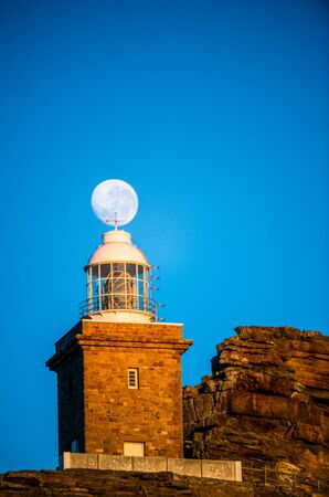 Lighthouse Cape of Good hope and moon in blue sky. South Africa. 写真素材