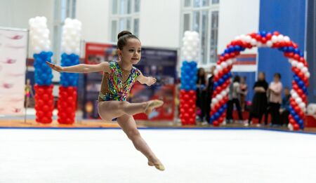Adorable sporty little girl in rhythmic gymnastics.