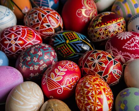 christian festival: A tight cluster of multicolored painted and decorated easter eggs  Stock Photo