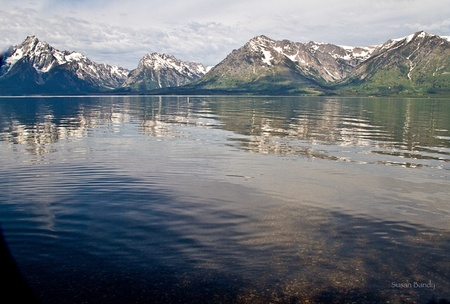 Beautiful Jackson Lake view of reflected Teton Mountain range on summer day. photo