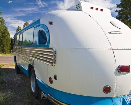Rear side view of restored Grand Teton Lodge Comapny touring bus.