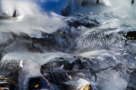 crystaline: Ice waves frozen as frigid water cascaded down a waterfal creating unique ice sculptures