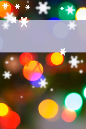 whimsey: Vertical background with light blue area on top for copy over a snowflaked and multicolored bokeh-lighted background