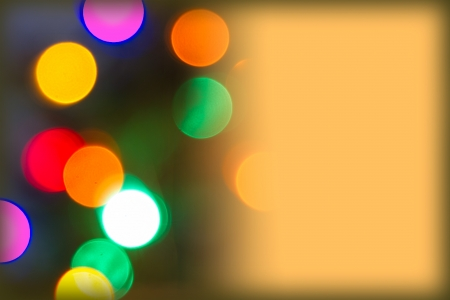 Horizontal background with gold area on right for copy over a multicolored bokeh-lighted background Stock Photo - 16587193