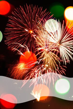 populate: Multicolored Bokeh lights and fireworks populate a night scene in a vertical background with a transparent space at bottom for copy.