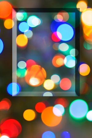 whimsey: Multicolored Bokeh lights populate a night scene in a vertical background with a raised beveled box for copy. Stock Photo