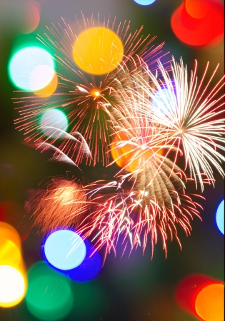 Multicolored Bokeh lights and fireworks populate a night scene in a vertical background. Stock Photo - 16791209