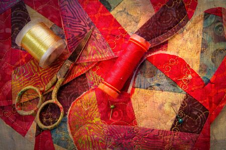Sewing supplies lay amid hand crafted valentines with a texture overlay. Stock Photo