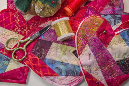 Sewing supplies lay amid hand crafted valentines.