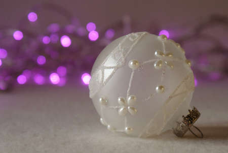 Christmas ornament and purple Christmas lights photo