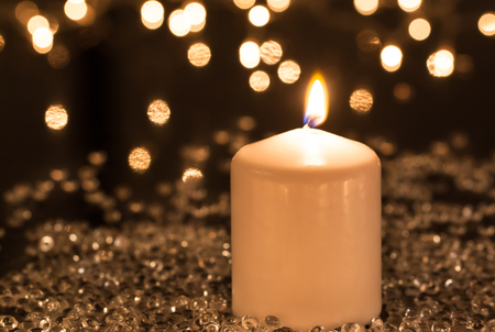 White candle and festive decorations