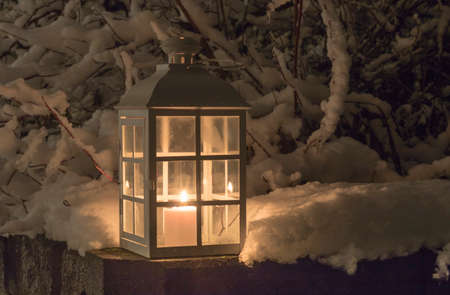 Lantern with a candle and snowy branches Stock Photo