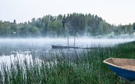 Misty morning by a calm lake Stock Photo