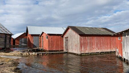 Old boat sheds by the sea Stock Photo
