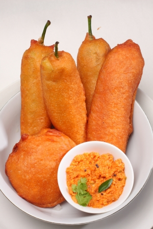 Chilli bajji, a common snack in south India, served with red hot coconut chutney