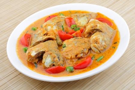 kerala culture: Coconut milk tomato fish curry   Stock Photo