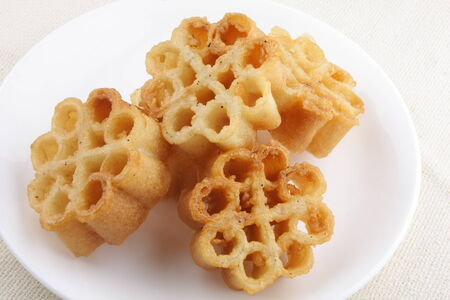 kerala culture:  on-Achappam is a traditional and popular snack in Kerala during festive times like christmas,Onam which is crunchy, mildly sweet in flower shape