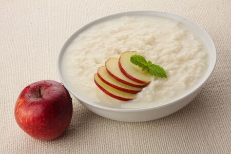 Rice pudding with milk and apples.
