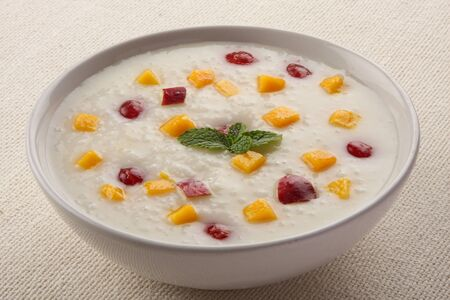 plum pudding: Healthy breakfast.Homemade rice pudding with mango and red plums