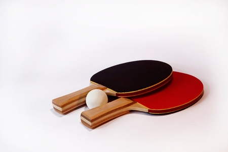 Table tennis bats and ball on white background photo