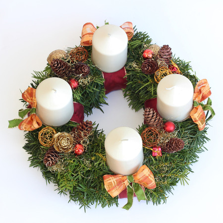 handmade advent wreath with white candles, cones, orange ribbons, isolated on white photo