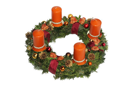 Advent wreath with cinnamon candles, golden cones and ribbon