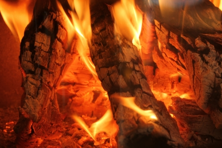 Closeup of burning logs in a chimney fire photo