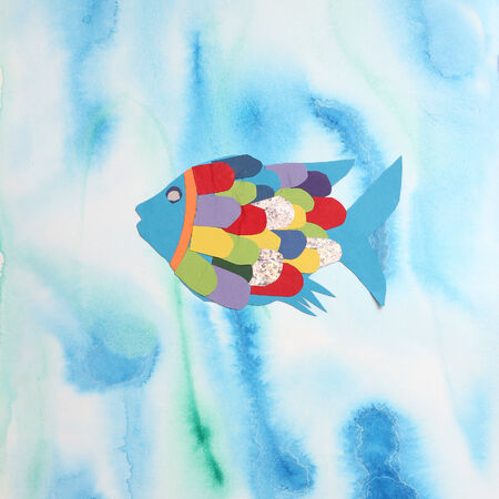 rainbow fish made of color paper on painted with watercolors, children artwork photo