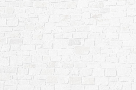 Light grey structured background with half transparent brick wall of natural rough stones