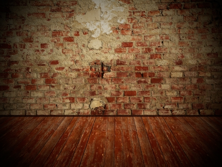 Damaged old brick wall and weathered wooden floor, rustical vintage room design with dark edges photo