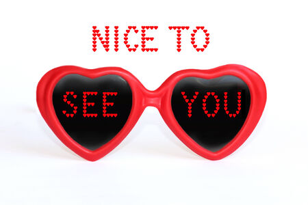 Nice to see you, friendly compliment text message, red heart shaped eye glasses, isolated on white photo