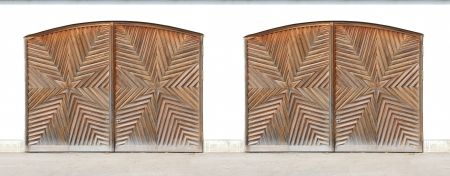 starlike: Wooden arched garage doors with starlike ornate Stock Photo