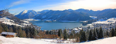 Panoramic view to lake schliersee, wintry german landscape photo