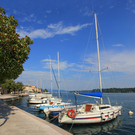 Sailboats at salo harbor, lake garda, italy