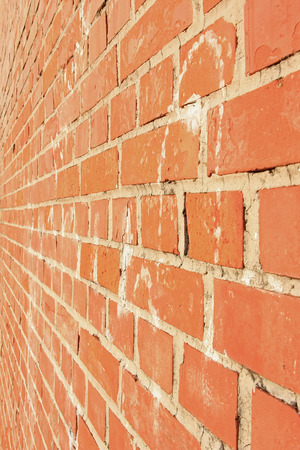 lateral view: Side view of a red brick wall, architectural background.