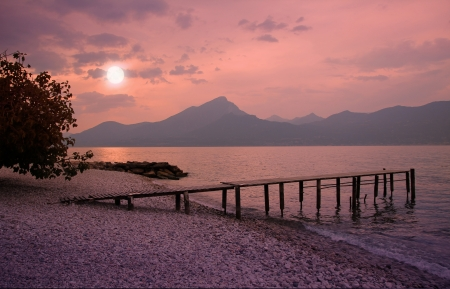 Garda lake beach in romantic moonlight scenery  photo