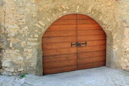 Wooden arched garage door